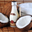 Coconut and massage oil — Stok fotoğraf