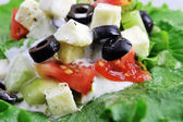 Salat with feta cheese and fresh vegetables — Stock Photo