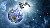 Space station over blue planet earth in space. — Stock Photo