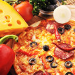Tasty pizza on plate — Stock Photo #24780995