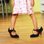 Girl in big shoes — Stock Photo