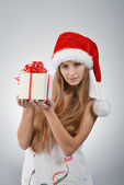 Young woman in santa claus — Stock Photo