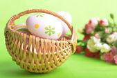Basket of easter eggs — Stockfoto