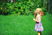 Girl with bubble blower — Stock Photo