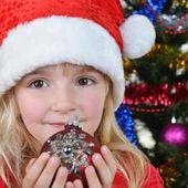 Girl near Christmas fir-tree — Stock Photo