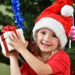 Girl in santa cap — Stock Photo #33102605