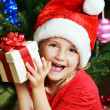 Girl in santa cap — Stock Photo #33102701