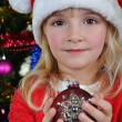 girl near Christmas fir-tree — Stockfoto