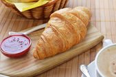 Fresh crusty croissant — Stock Photo
