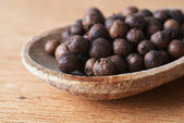 Allspice in spoon — Stock Photo