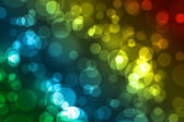 Beautiful bokeh over multicolored backgrond — Stock Photo
