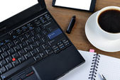 notebook and cup of coffee — Стоковое фото