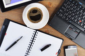 Open notebook and coffee — Stock Photo