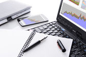 Open notebook and computer — Stockfoto