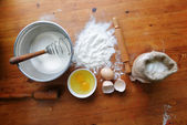 flour on wooden background — Stock Photo