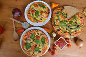 Pizzas with olives and peppers — Stock Photo