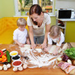 Mother with children on kitchen — Stock Photo #50790071