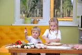 Children prepare pizza — Stock Photo