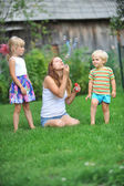 Family with bubble blower — Stock Photo