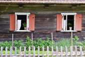 Windows of wooden house — Stock Photo