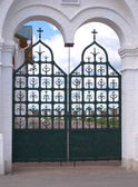 Black decorative church gate closeup — Stock Photo