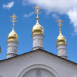 Stock Photo: Churh cupolas over blue sky with clouds