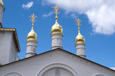 Churh cupolas over blue sky with clouds — Stock Photo