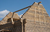Top of wooden house construction from timber — Stock Photo