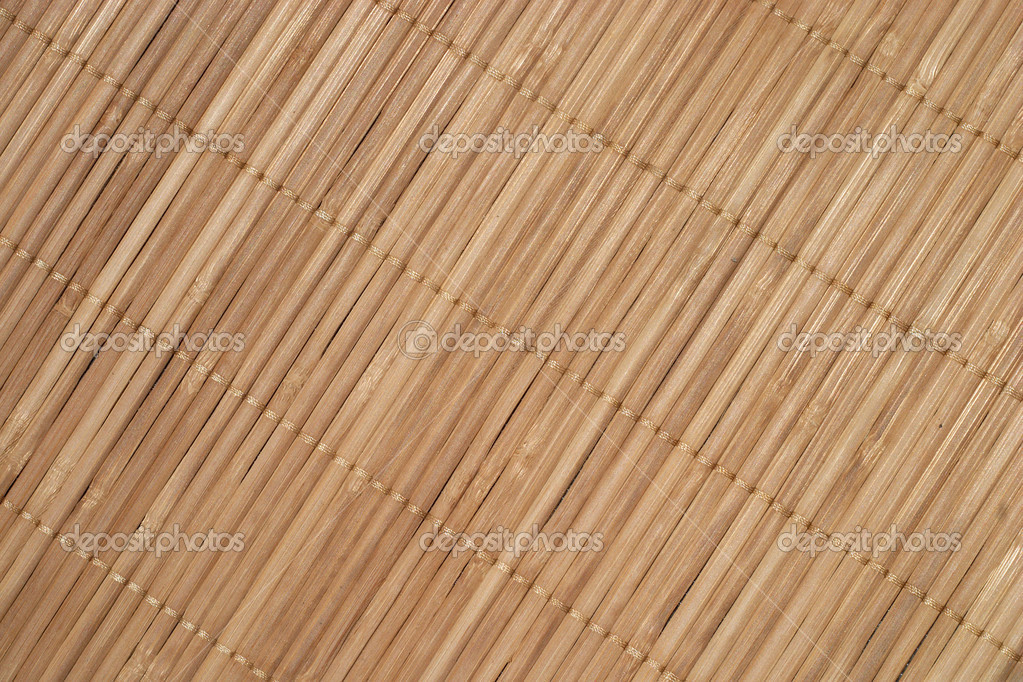 Brown straw mat diagonal background closeup — Stock Photo #12326227