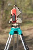Electronic tacheometer on tripod vertical view — Stock fotografie