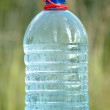 Stock Photo: Plastic cwith ecologically pure drinking water