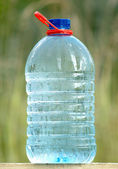 Plastic can with ecologically pure drinking water — Stock Photo