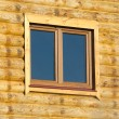 Wood logs house wall with window — Stock Photo