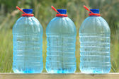 Plastic cans with cold ecologically pure drinking water — Stock Photo