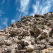 Landscape with stony mountain top under wonderful sky with clouds — Stock Photo