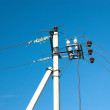 Prop of power supply line over blue sky — Stock Photo