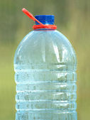 Plastic can with ecologically pure drinking water closeup — Stock Photo