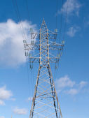 High-voltage power line metal tower with wires vertical view — Stockfoto