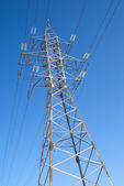 High-voltage power line metal prop over clear cloudless blue sky — Stock Photo