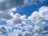 Many rain clouds on blue sky in summer — Stock Photo