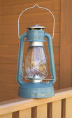 Retro oil kerosene lantern on country house fence closeup — Stock Photo