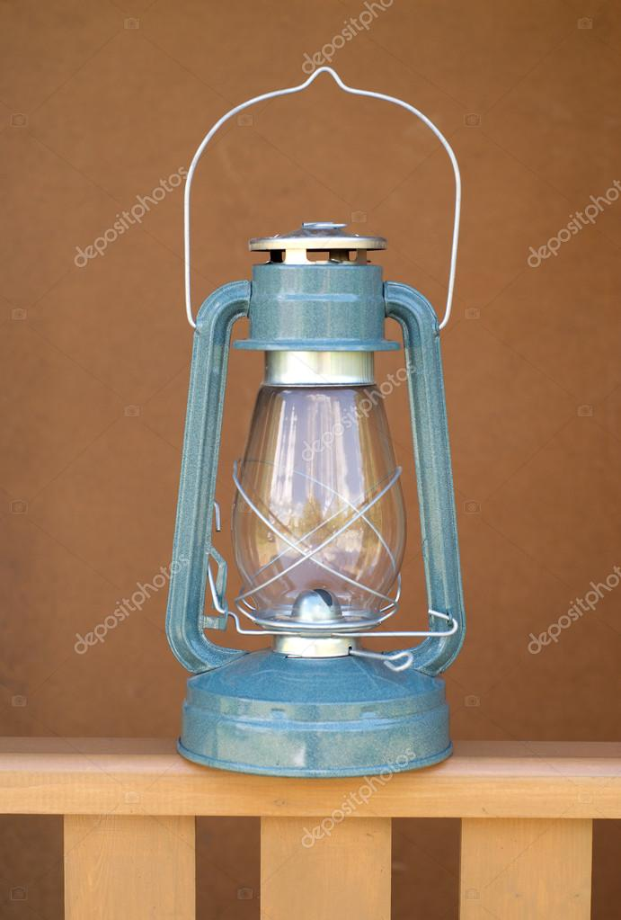 Vintage kerosene lamp on wood fence closeup  Stock Photo #12758620