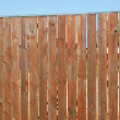 High brown verttical wooden boundary closeup — Stockfoto #12842460