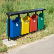 Colored trash containers in a park — Stock Photo