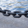 Black chain links closeup before sea embankment - Stock Photo