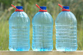 Plastic cans with ecologically pure drinking water — Stock Photo