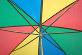 Under color sun umbrella — Stock Photo