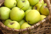 Apples in basket closeup — Stock Photo
