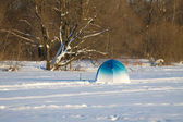 Fisherman color tent on frozen river with snow — Stok fotoğraf