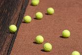 Court, tennis balls and net closeup — Stock Photo